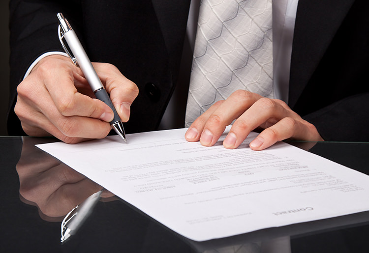 Signing a Business Loan Agreement