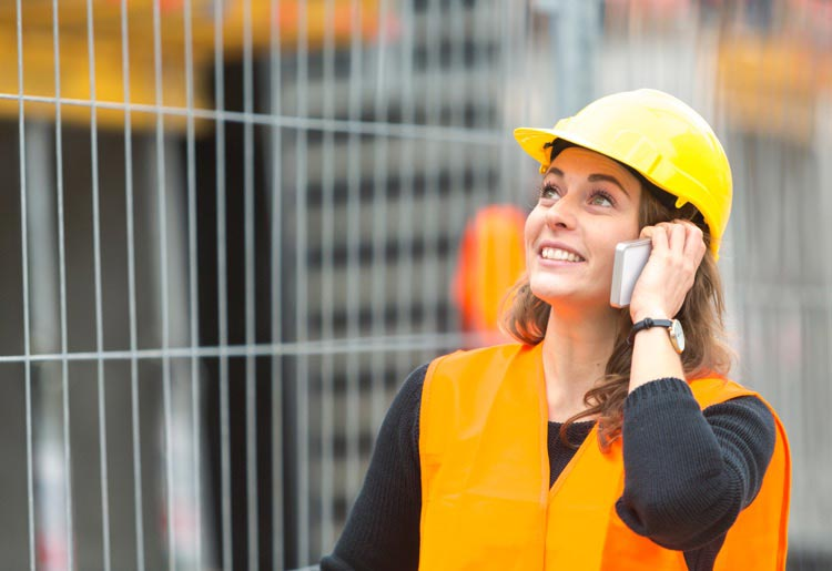 Construction worker on VoIP phone