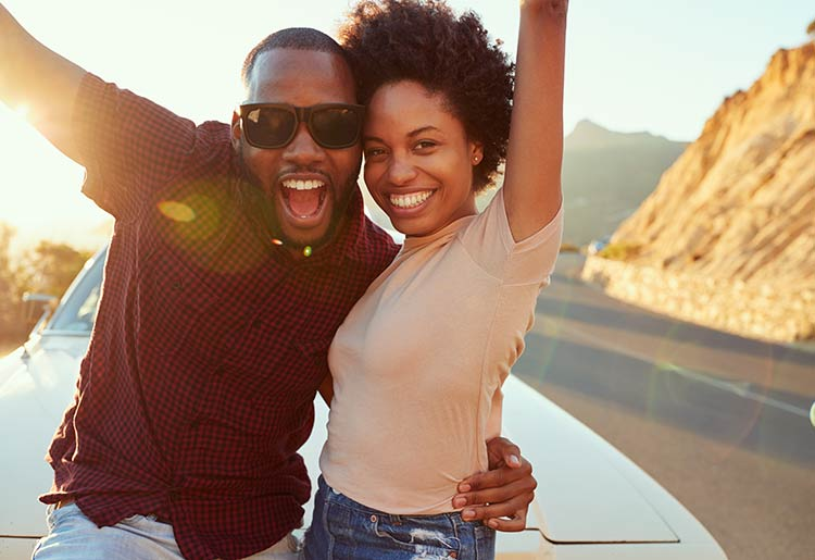 Happy black couple outdoors - best dating sites