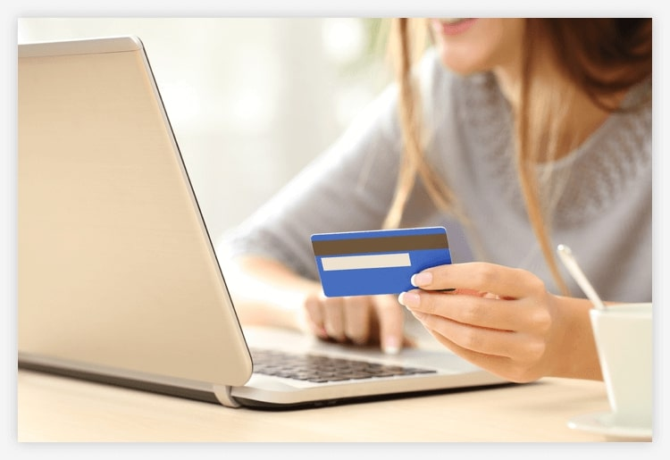 Photo of woman shopping on laptop