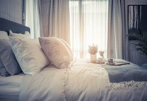 Best Mattresses Under $1,000 - Cozy Bed in Morning Light