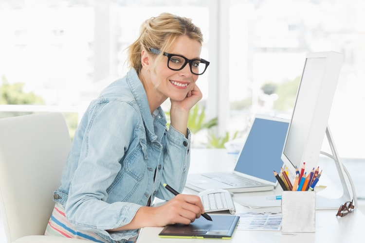 Graphic designer being happy about creating awesome designs