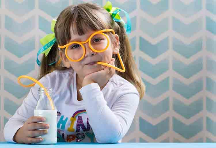 child sipping milk