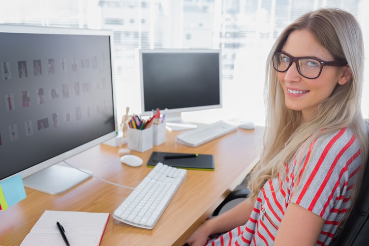 graphic designer turning to look at camera