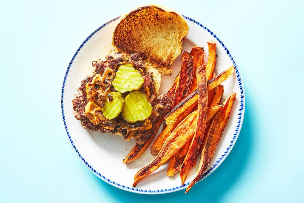 Chipotle Burger with Pickles and Sweet Potato Wedges