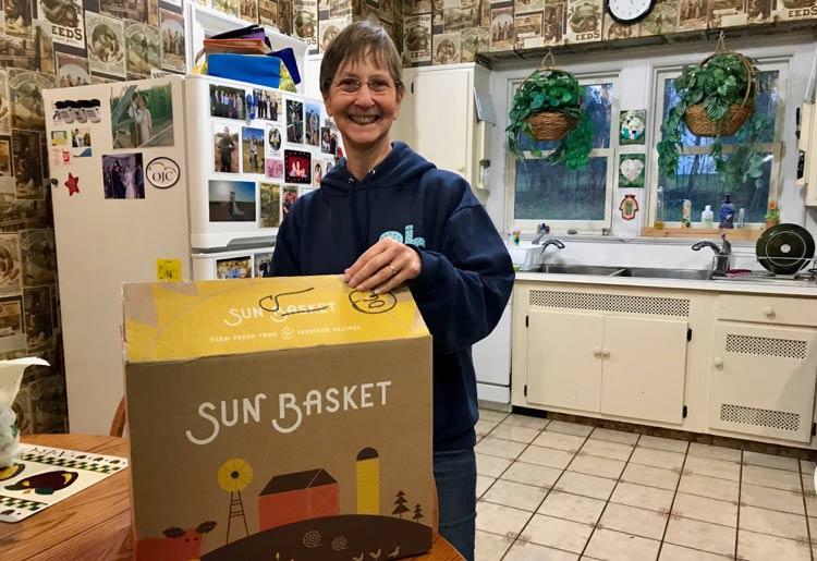 Paula Mack receiving Sun Basket box